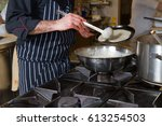 chef cooking omelette in a... | Shutterstock . vector #613254503