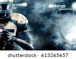 Small photo of American football sportsman player on stadium with lights on background with copy space