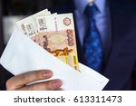 Small photo of Salaried employee in an envelope. Focus on money.