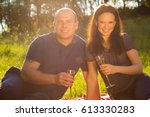 a young man and woman on picnic. | Shutterstock . vector #613330283
