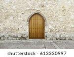 old medieval door  detail of an ... | Shutterstock . vector #613330997