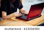 woman's hands holding credit... | Shutterstock . vector #613336583