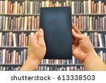 a book on student hand in the... | Shutterstock . vector #613338503