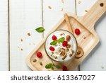 homemade yogurt with granola ... | Shutterstock . vector #613367027