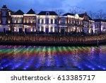 night canal lights at huis ten...   Shutterstock . vector #613385717