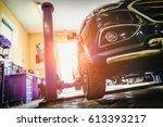 car in garage of auto repair... | Shutterstock . vector #613393217