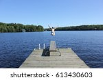 man jumping off dock | Shutterstock . vector #613430603