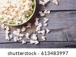 salt popcorn on the wooden...   Shutterstock . vector #613483997