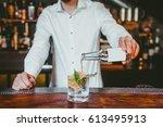 bartender making alcoholic... | Shutterstock . vector #613495913