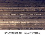 brown wood planks with worn... | Shutterstock . vector #613499867
