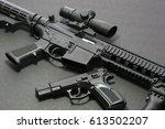 handgun with rifle over dark... | Shutterstock . vector #613502207
