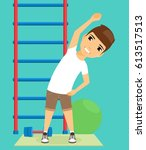 the boy is doing workout in the ... | Shutterstock .eps vector #613517513