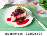 cheesecake on white plate with... | Shutterstock . vector #613526633