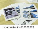 paper with pen on wood desk.   Shutterstock . vector #613552727