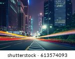 the traffic light trails of city | Shutterstock . vector #613574093