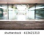 wooden board empty table in... | Shutterstock . vector #613621313