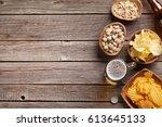 lager beer mug and snacks on... | Shutterstock . vector #613645133