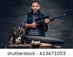 studio portrait of a bearded... | Shutterstock . vector #613671053