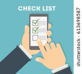 check list app on smartphone.... | Shutterstock . vector #613698587