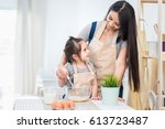 happy family cooking biscuits... | Shutterstock . vector #613723487