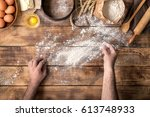 males hands sprinkle with flour ... | Shutterstock . vector #613748933