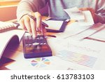 man using calculator and... | Shutterstock . vector #613783103