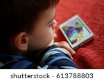 little boy with tablet  ... | Shutterstock . vector #613788803