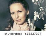 beautiful woman in spring... | Shutterstock . vector #613827377