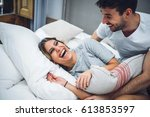 young sweet couple laughing... | Shutterstock . vector #613853597