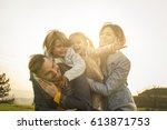 happy and  cheerful family... | Shutterstock . vector #613871753