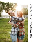 best friends concept  two young ... | Shutterstock . vector #613872407