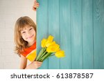 beautiful child with bouquet of ... | Shutterstock . vector #613878587