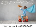 child pretend to be pilot. kid... | Shutterstock . vector #613883483