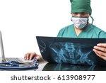 doctor sitting at office desk...   Shutterstock . vector #613908977