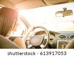 young beautiful woman driving... | Shutterstock . vector #613917053