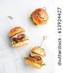 tasty burger and cheeseburger... | Shutterstock . vector #613924427