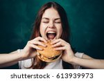 the woman opened her mouth to... | Shutterstock . vector #613939973