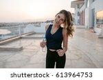 active slim young woman in... | Shutterstock . vector #613964753