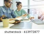 male and female colleagues... | Shutterstock . vector #613972877