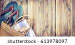 summer accessories closeup on... | Shutterstock . vector #613978097