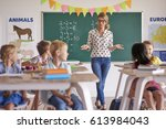 female teacher with pupils in... | Shutterstock . vector #613984043