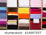 Small photo of stack of accurately lying bad towels on shop shelves in textile department