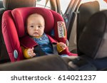 father fasten his little baby... | Shutterstock . vector #614021237