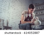 man in a potter's wheel | Shutterstock . vector #614052887