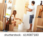 young couple decorate their new ... | Shutterstock . vector #614087183