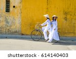 Vietnam Girls Ride A Bicycle...