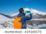 man photographed mountains in... | Shutterstock . vector #614160173