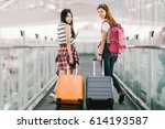 two happy asian girls traveling ... | Shutterstock . vector #614193587