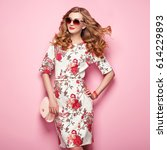 blonde young woman in floral... | Shutterstock . vector #614229893