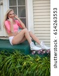 beautiful blond girl on roller... | Shutterstock . vector #614263553